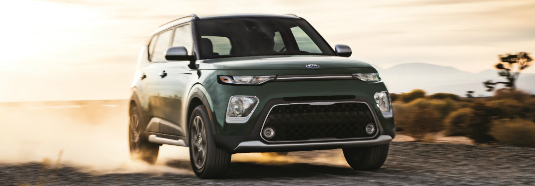 green 2020 Kia Soul driving through desert
