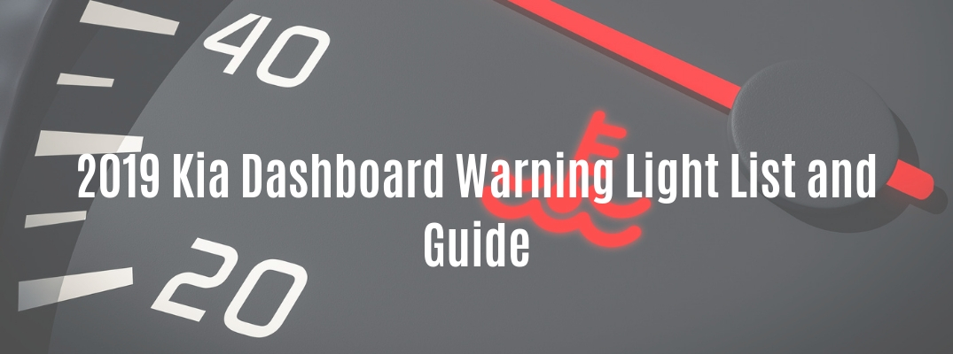 "Closeup of dashboard with ""2019 Kia Dashboard Warning Light List and Guide"" white text"