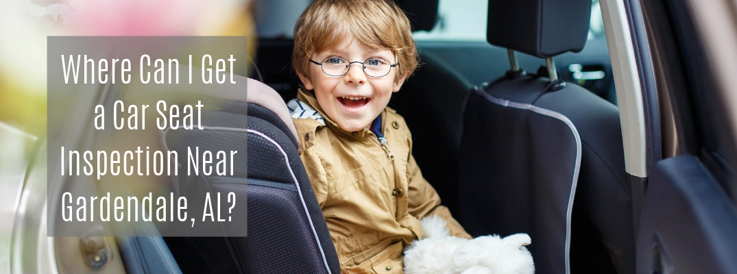 "Preschool-aged boy in car with ""Where Can I Get a Car Seat Inspection Near Gardendale, AL?"" white text"