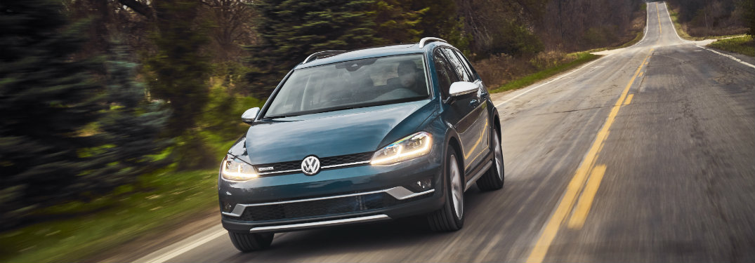 Front end of the 2018 Volkswagen Golf Alltrack as it drive down a hill