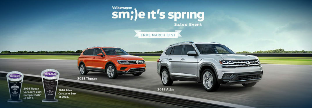 Volkswagen Tiguan and Atlas driving down highway with Smile It's Spring sales banner text