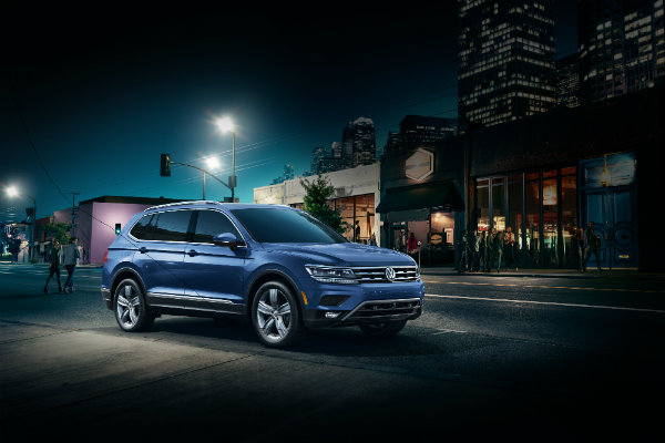 Blue 2019 Volkswagen Tiguan parked at night