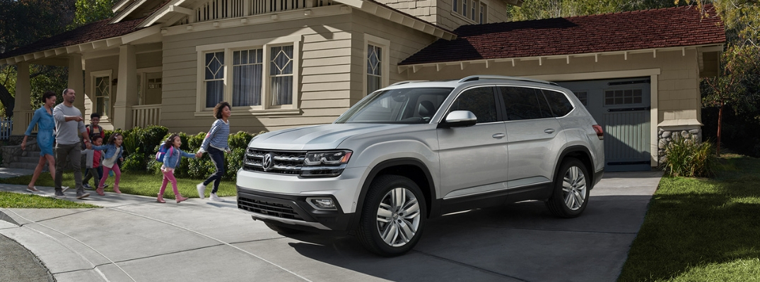 Silver 2019 VW Atlas Parked in a Driveway with Family and Kids
