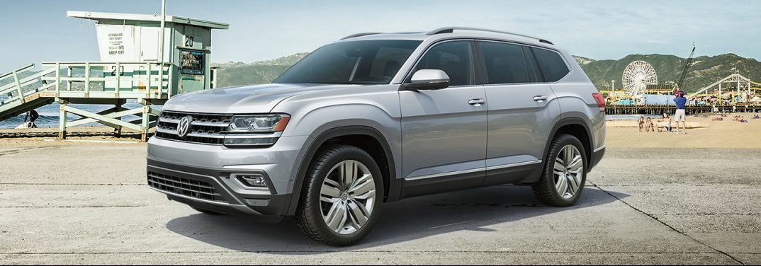Front driver angle of a silver 2019 Volkswagen Atlas parked on a beach