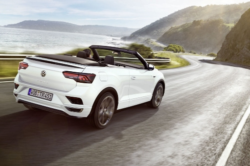 2020 VW T-Roc convertible driving on road near coast