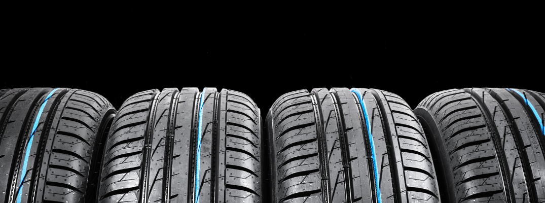 Set of four winter tires in black background