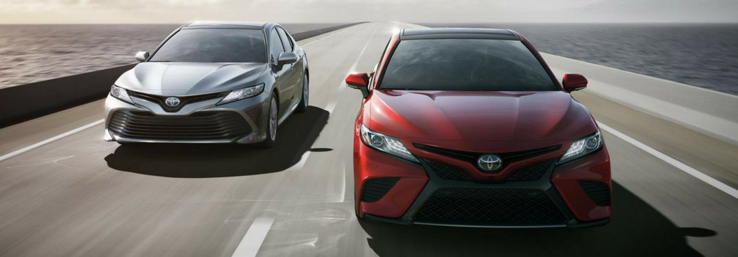 Two 2018 Toyota Camry Models in White and Red Coloring