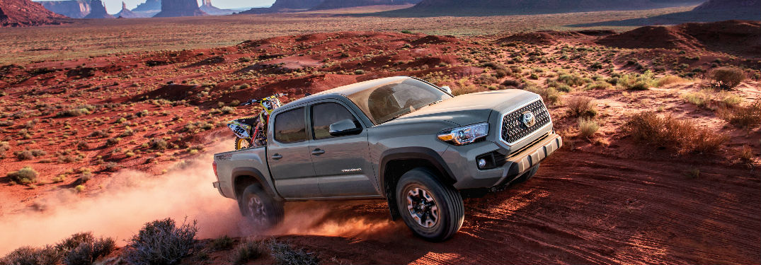 2018 Toyota Tacoma Exterior View in Silver Driving Down a Dirt Road