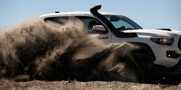 2019 Toyota Tacoma TRD Pro Exterior View in White Kicking Up Sand