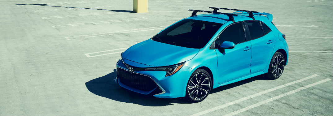 2019 Toyota Corolla Hatchback in Blue Exterior Coloring Front End and Side View