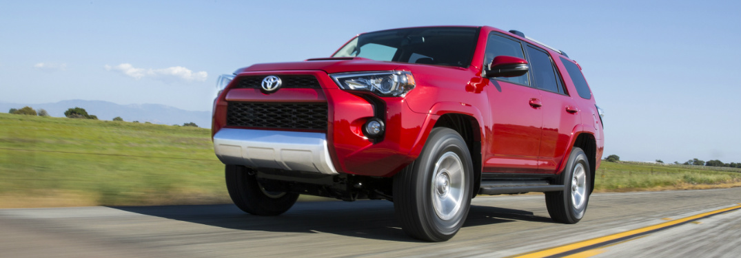 2018 Toyota 4Runner in red driving down a country road