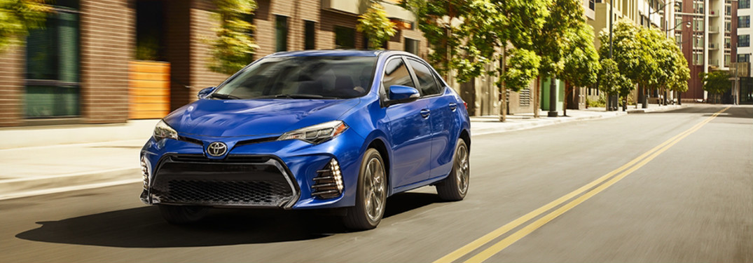 2018 Toyota Corolla in a bold blue driving down city streets