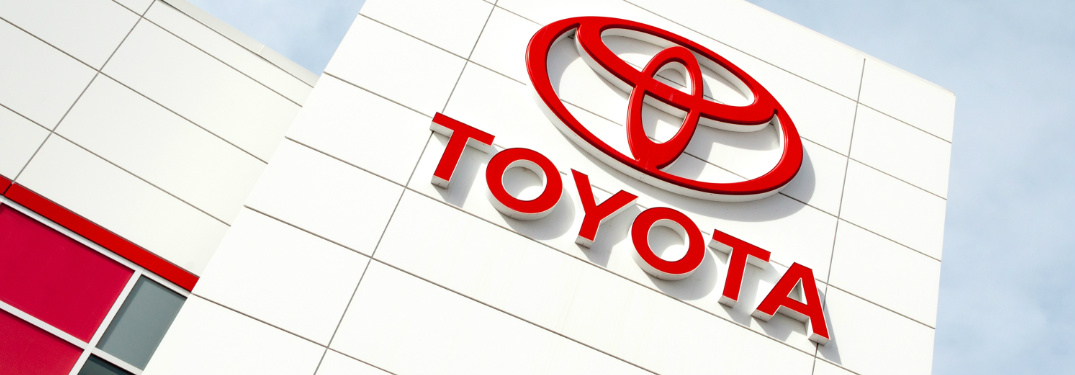 Toyota logo on the side of a Toyota dealership