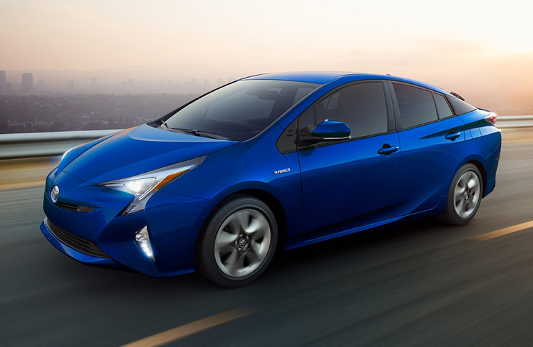 2018 Toyota Prius in bright blue driving on the highway
