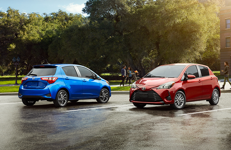 Two 2018 Toyota Yaris models parked in an empty lot