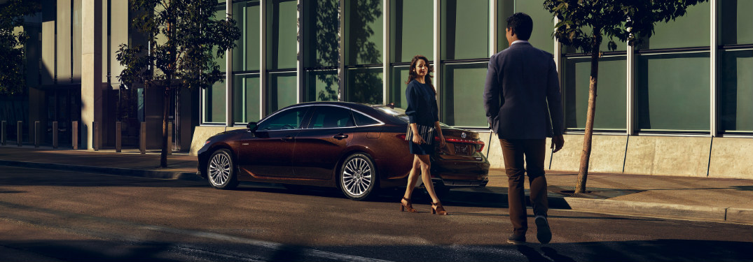 2019 Toyota Avalon in Opulent Amber parked on the side of a city street