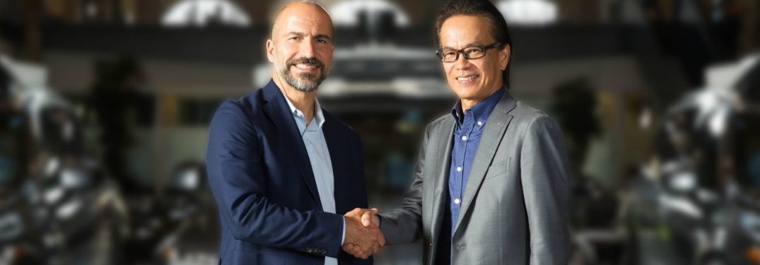 Toyota and Uber executives shaking hands
