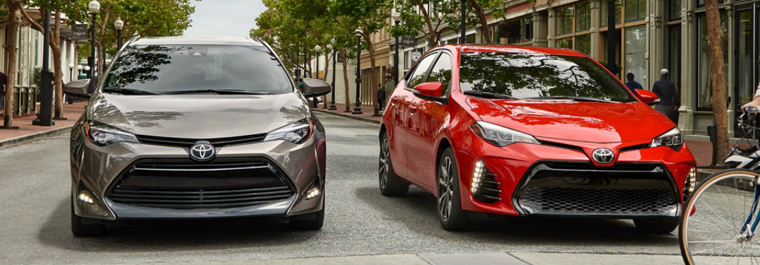 Two 2019 Toyota Corolla models in Flacon Grey Metallic and Barcelona Red Metallic at a crosswalk