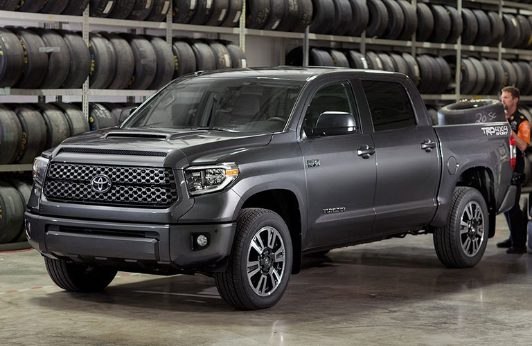 2018 Toyota Tundra parked in front of a wall of tires