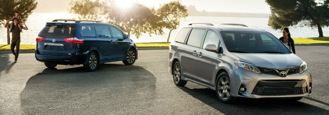 Two 2019 Toyota Sienna models parked in an empty lot near the water