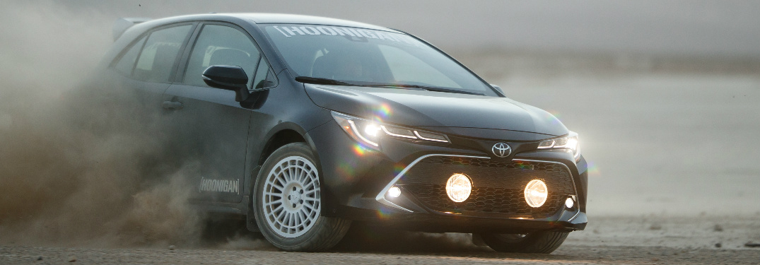 Custom SEMA 2019 Toyota Corolla Hatchback kicking up dirt while driving