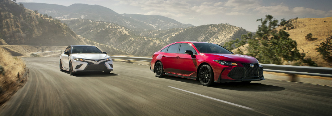 Toyota Camry TRD and Toyota Avalon TRD driving on a winding road in the mountains