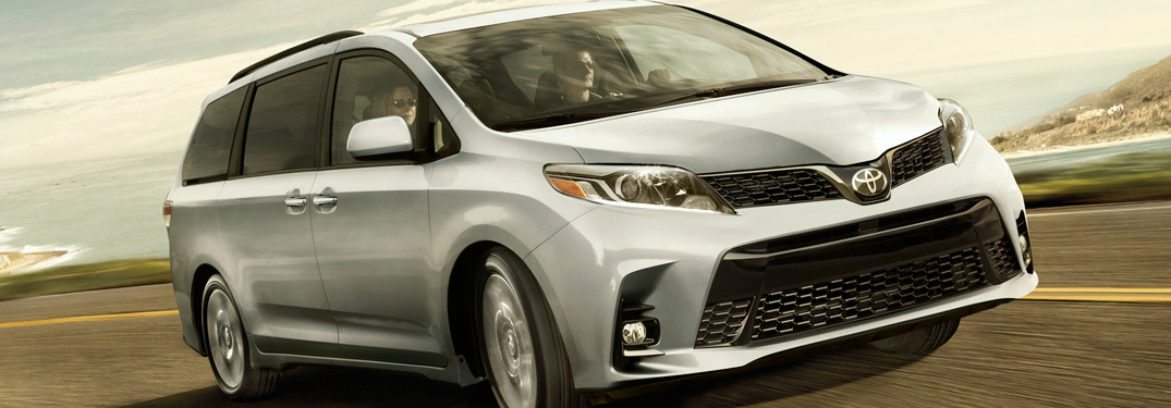 Family driving a 2019 Toyota Sienna near the ocean