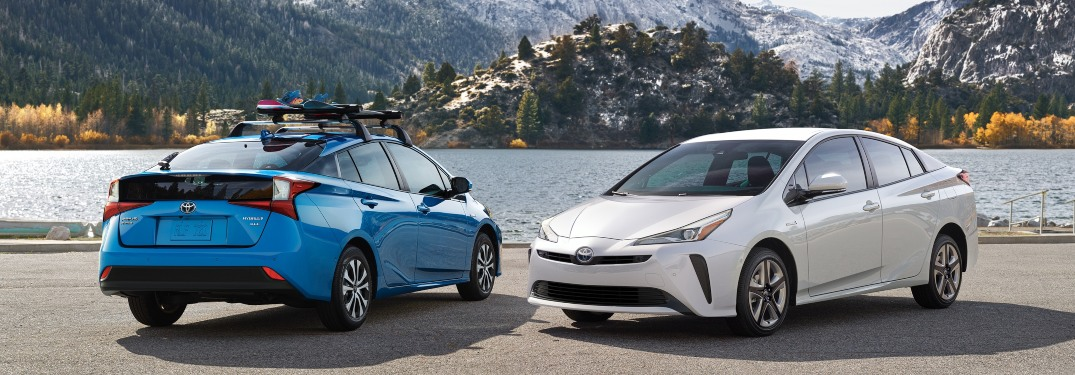 2019 Toyota Prius models blue and white side by side