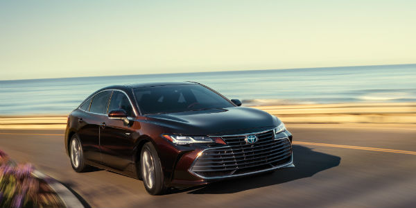 Front view of black 2020 Toyota Avalon driving