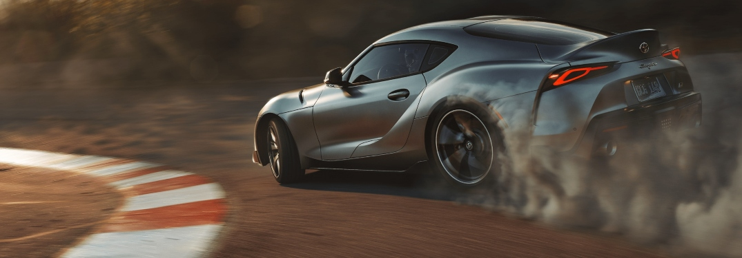 2020 Toyota GR Supra silver back view smoking tires