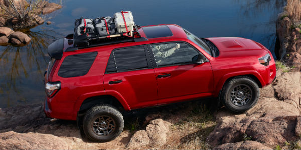 Red 2020 Toyota 4Runner Venture Edition on rocks
