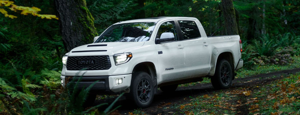 White 2020 Toyota Tundra driving in forest