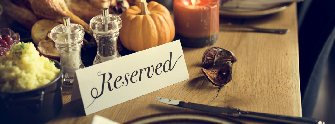 "Thanksgiving dinner table with ""reserved"" note"