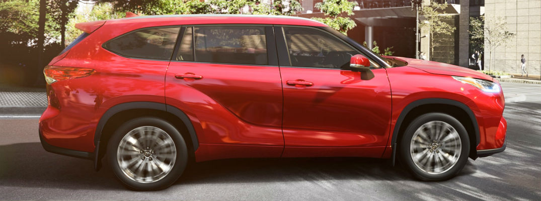 Side view of red 2020 Toyota Highlander Hybrid