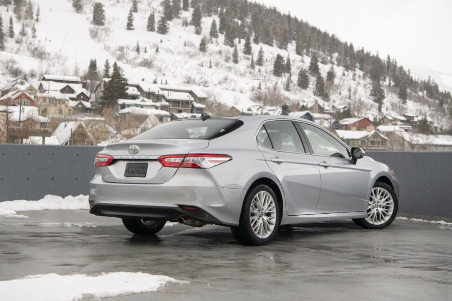 A rear right quarter photo of the 2020 Toyota Camry with AWD.