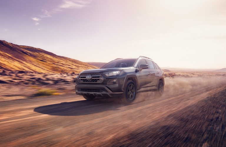 A photo of the 2020 Toyota RAV4 in motion on a grave road.