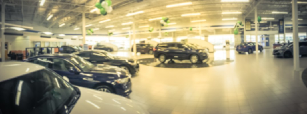 A photo illustration of the showroom of a car dealership's showroom.