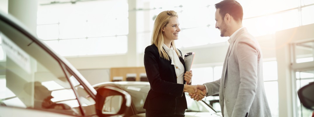 A stock photo of a customer completing a deal with a handshake.