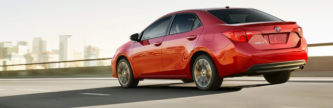 2019 Toyota Corolla red driving down sunny highway