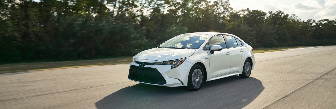 white 2020 toyota corolla on road