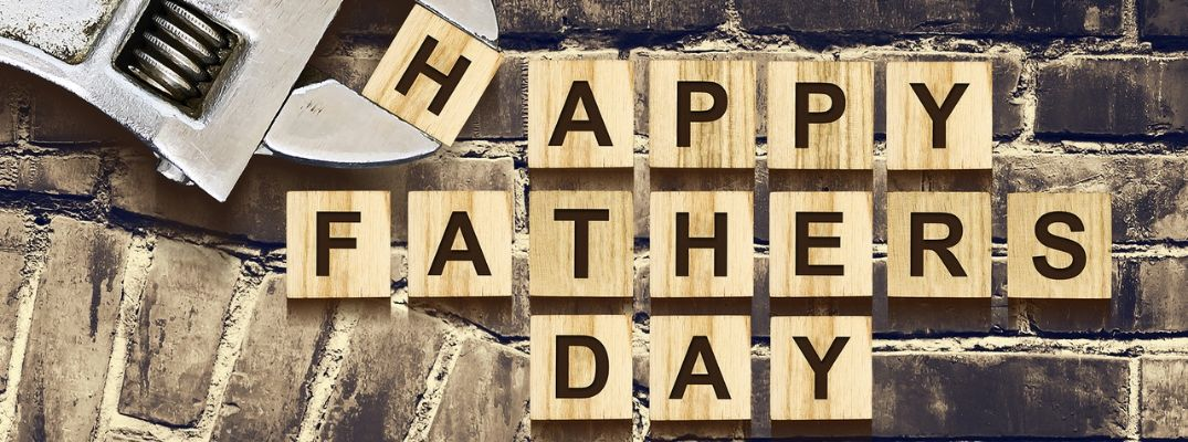 """Scrabble letters spelling """"Happy Fathers Day"""" with wrench holding """"H"""" tile"""
