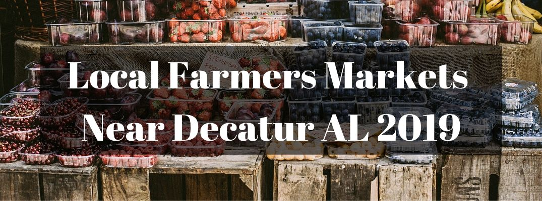 """Produce on wood shelves with """"Local Farmers Markets Near Decatur AL 2019"""" white text"""