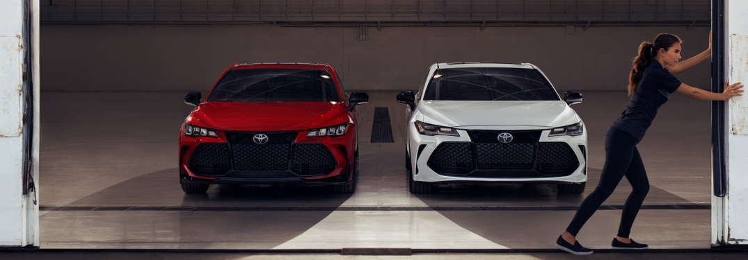 Two 2020 Toyota Avalon Sedans being unveiled by a woman