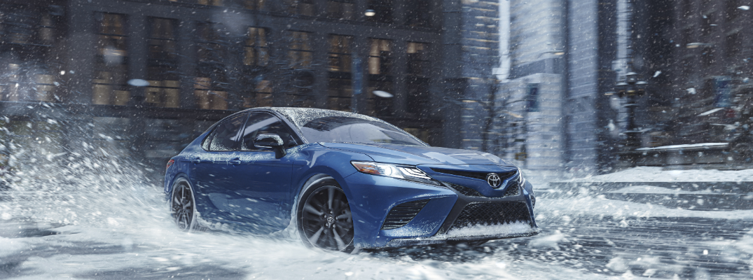 Blue 2020 Toyota Camry AWD in snow