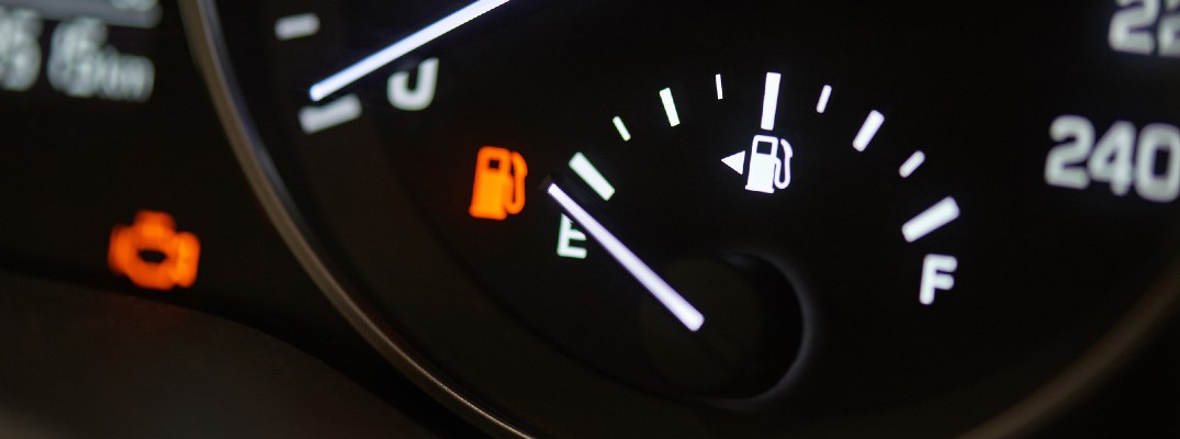 A stock photo of a car's fuel gauge on empty.
