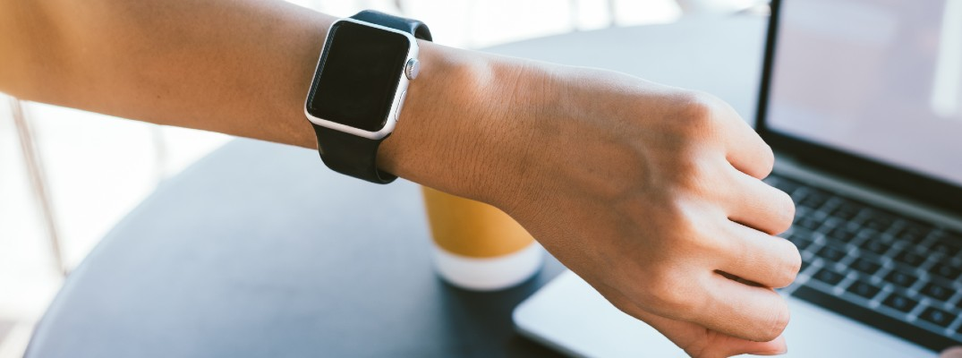 A stock photo of a person wearing a smartwatch.