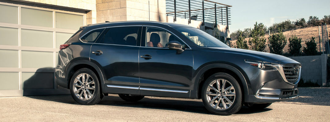 2018 Mazda CX-9 Exterior View in Black Parked in Driveway