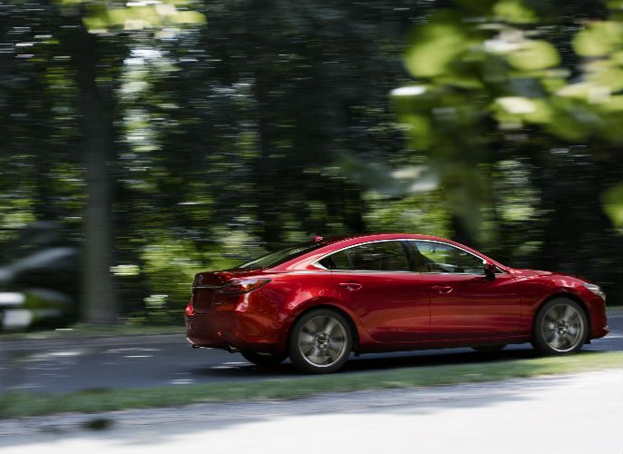 2018 Mazda6 Driving Down Road in Red Exterior Coloring