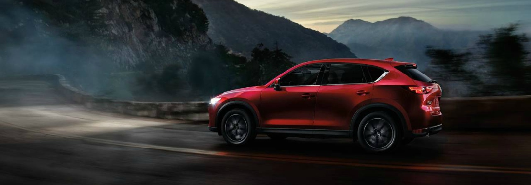 red 2018 Mazda CX-5 side view at night