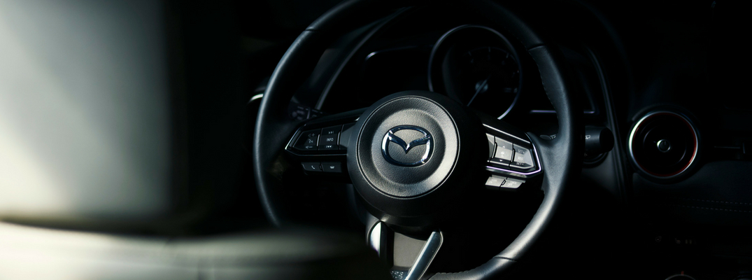 2019 Mazda CX-3 close-up view of steering wheel illuminated through shadows